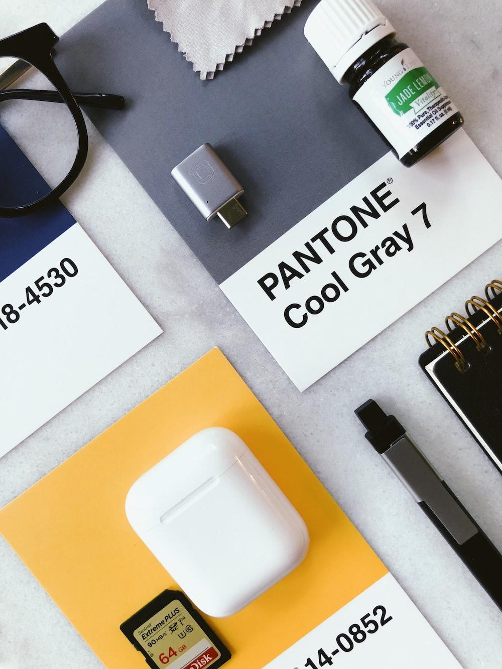 white usb flash drive on white printer paper