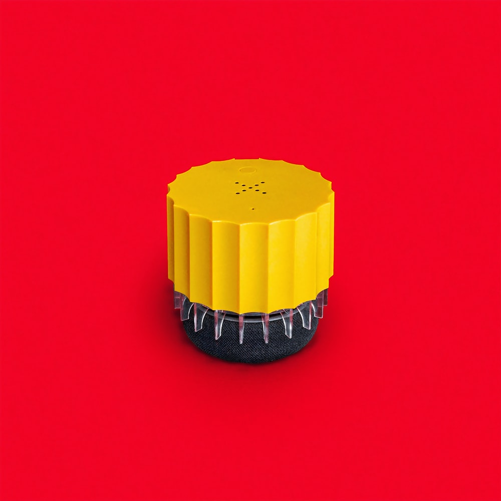 yellow and black round plastic container