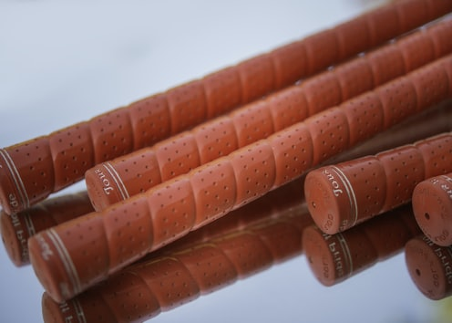 red plastic tube lot on white surface