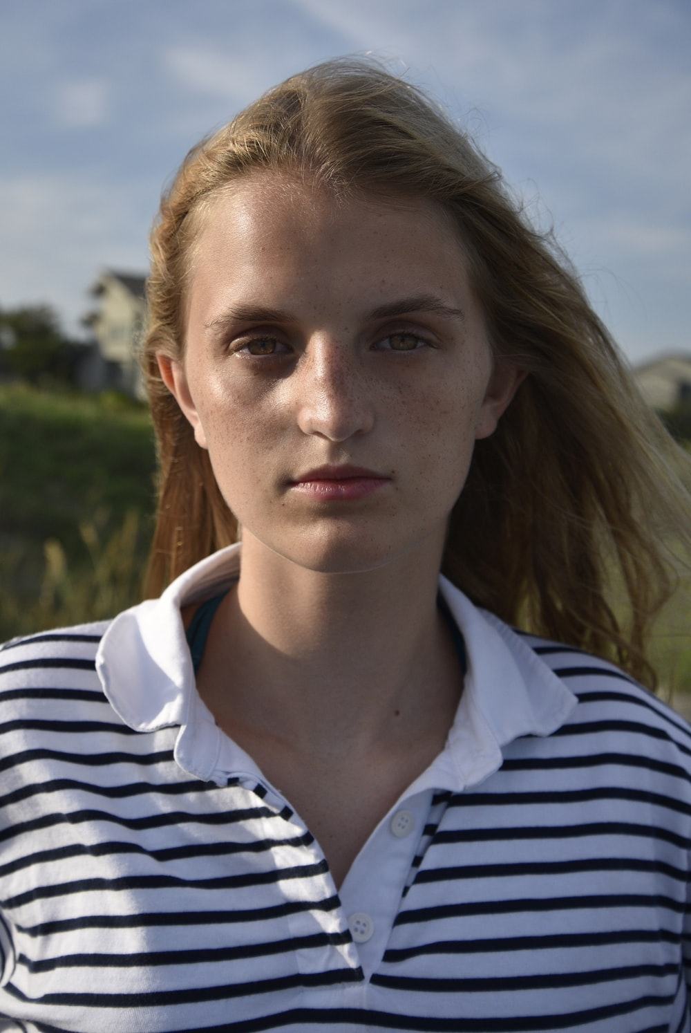 woman in black and white striped shirt