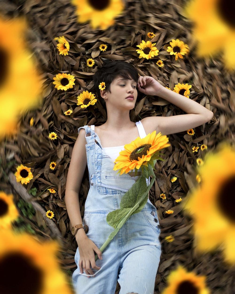 woman in white tube dress standing on sunflower field