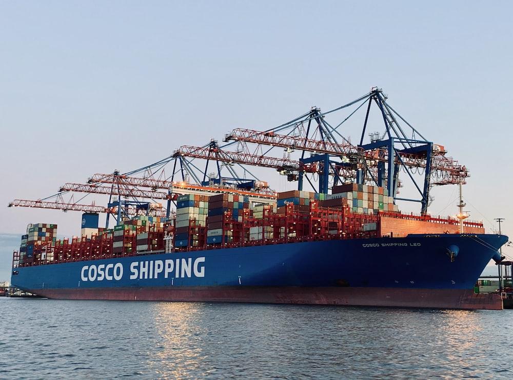 cargo ship on dock during daytime