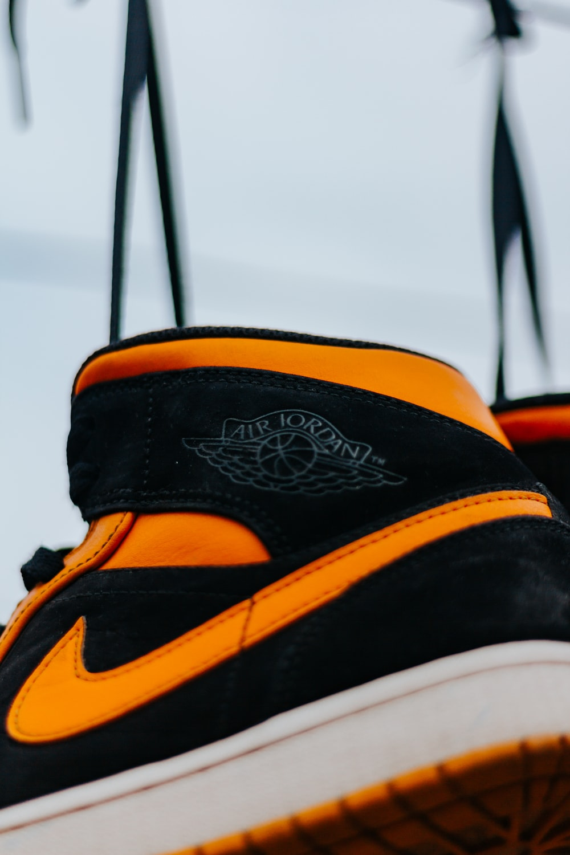 black orange and white nike high top sneakers