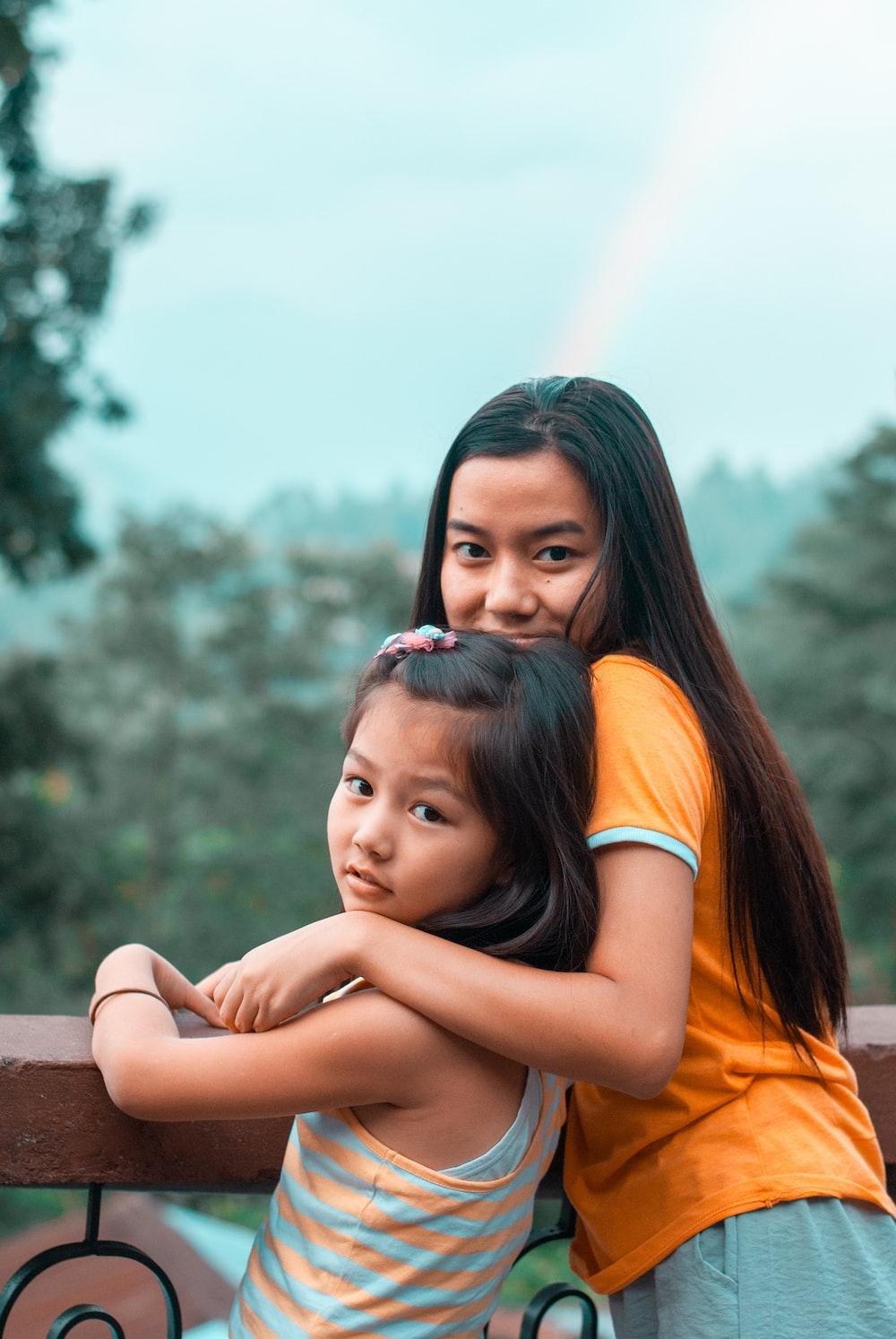 girl in orange tank top
