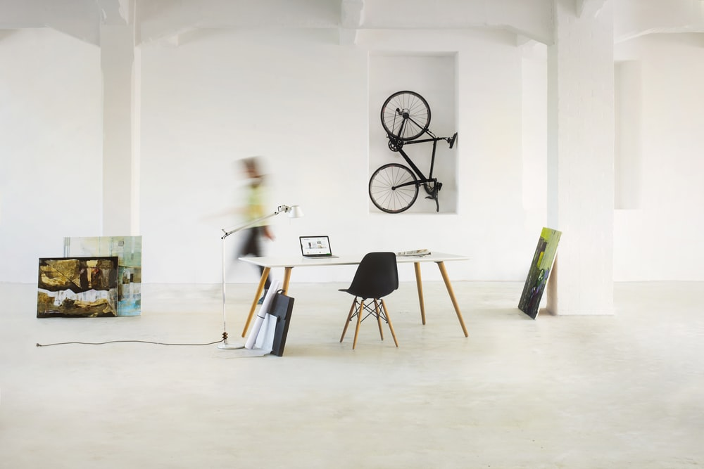 black and white wall mounted bicycle rack