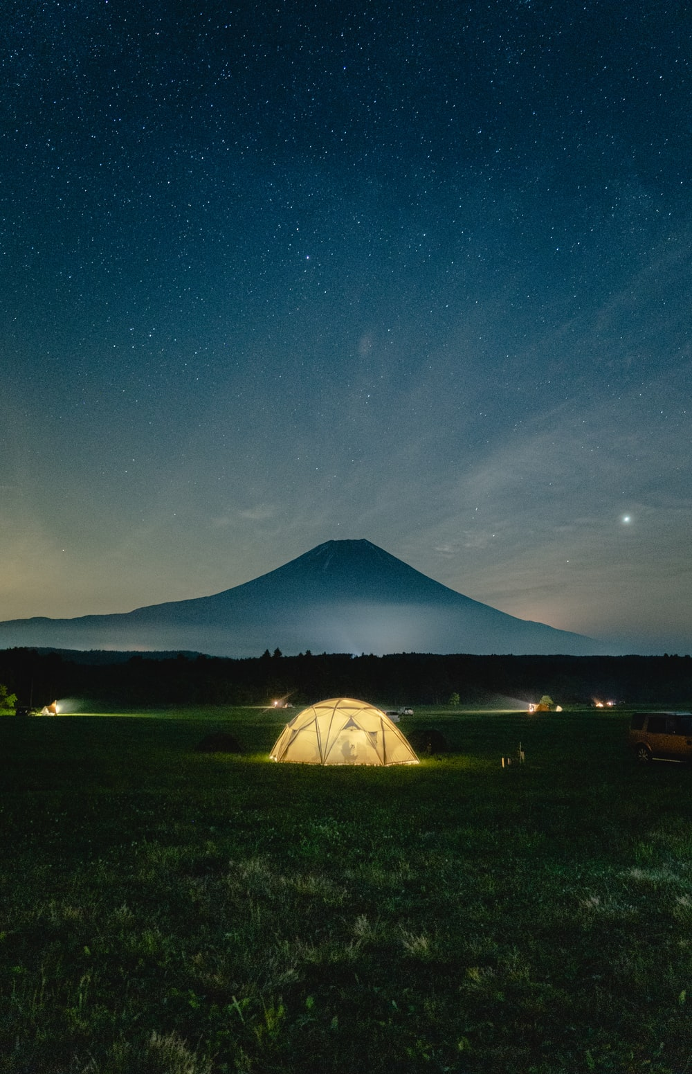 white tent under blue sky during night time