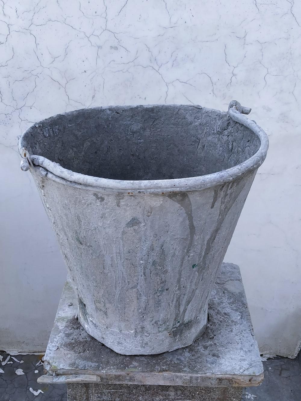 gray concrete bucket on gray concrete floor