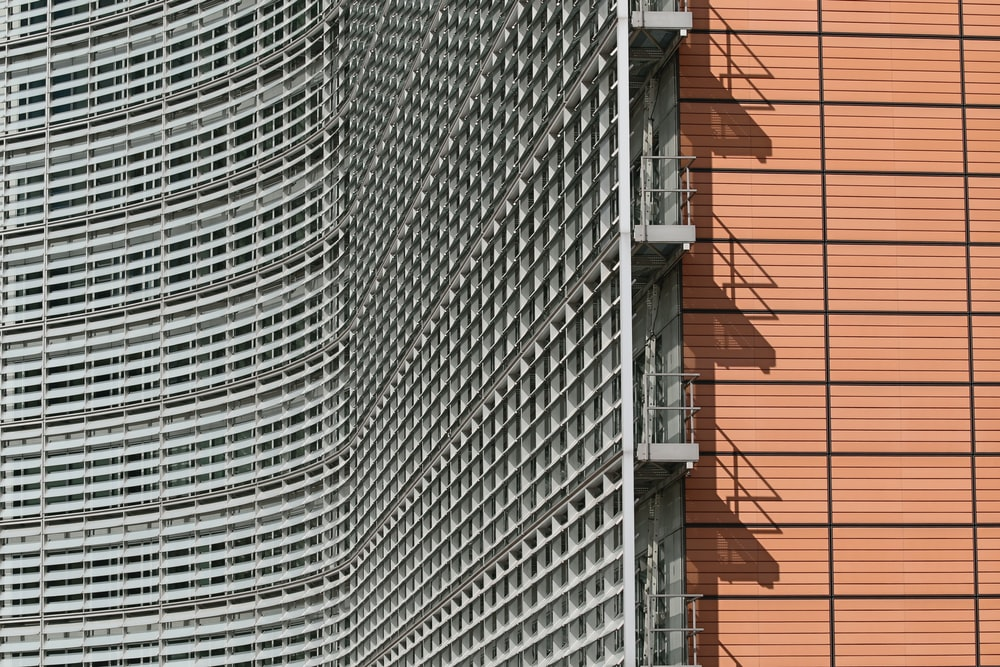 gray metal ladder on brown brick wall