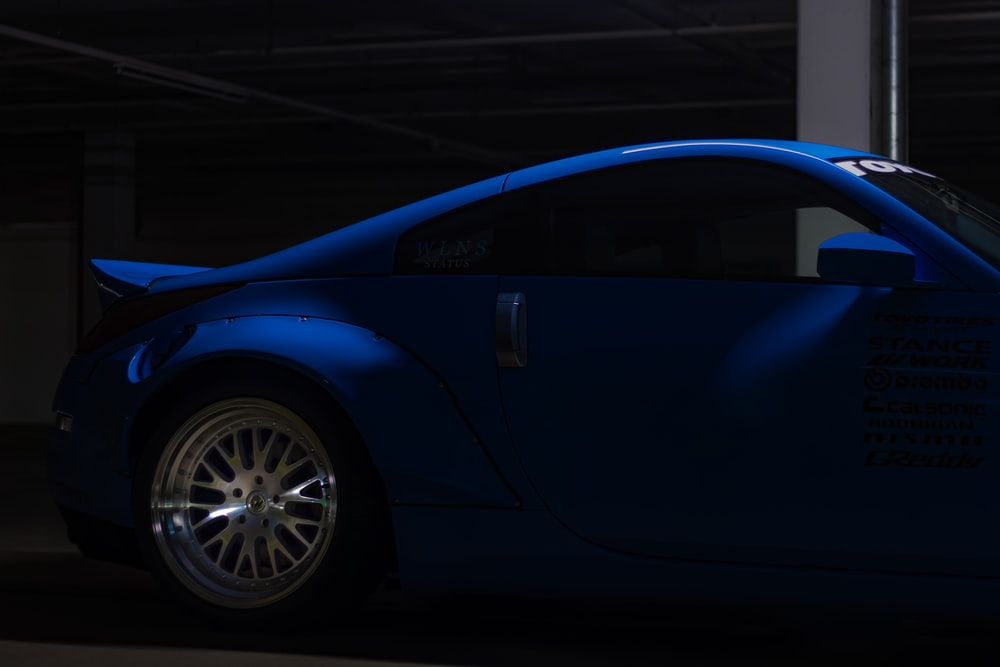 blue car parked on parking lot