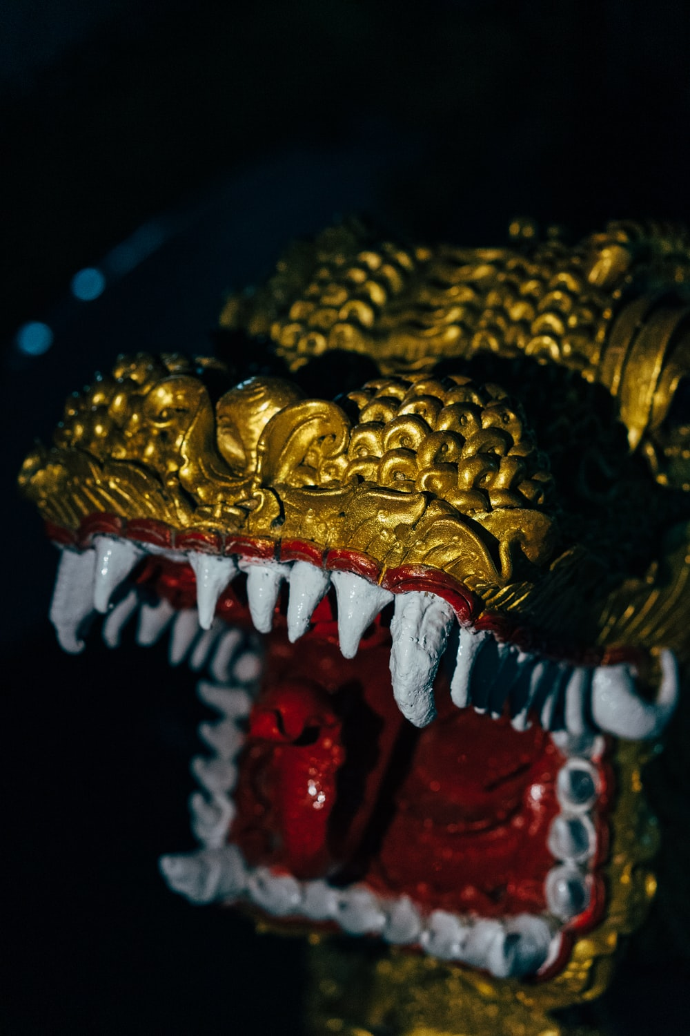 gold and red dragon figurine