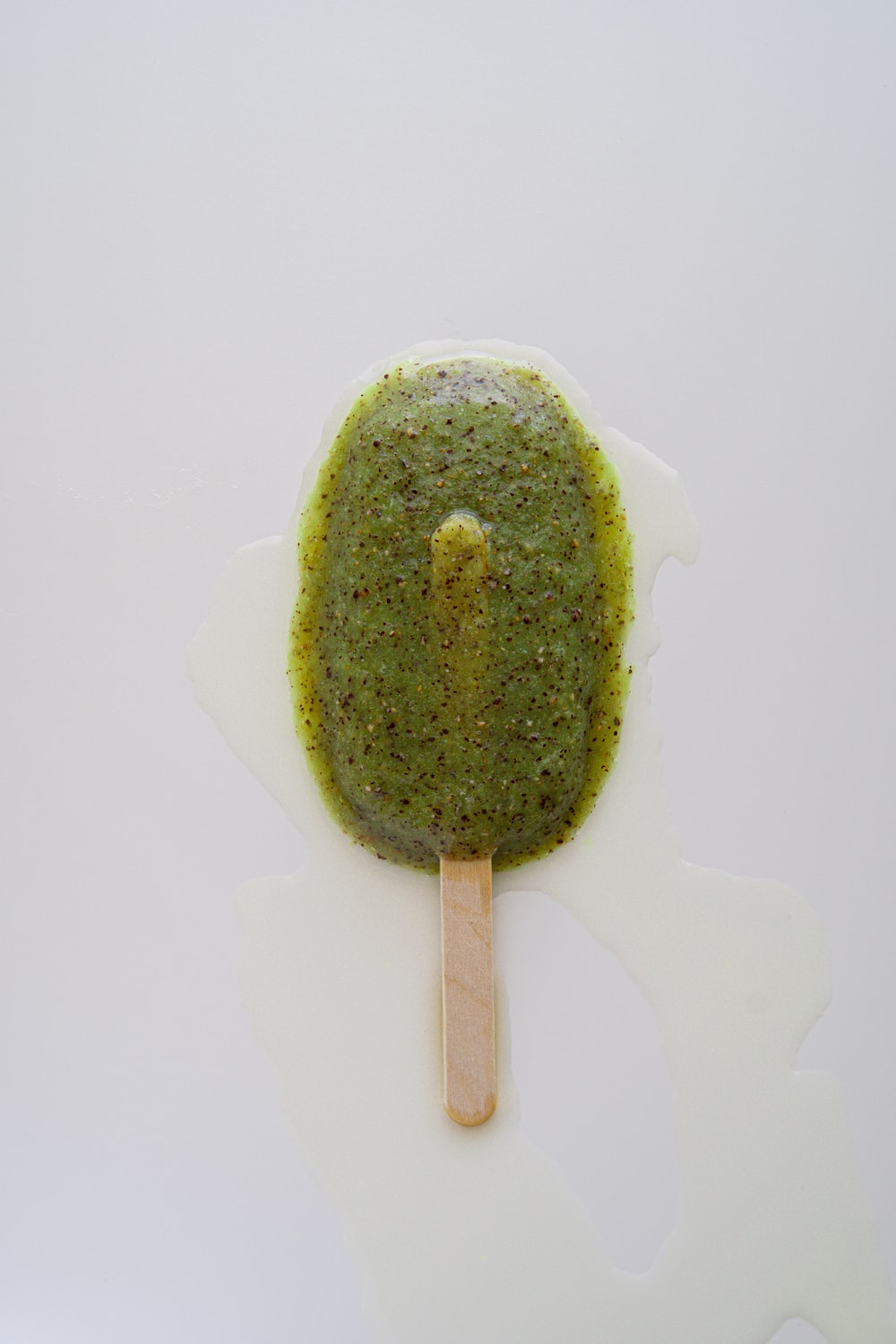 green and brown cake on white ceramic plate
