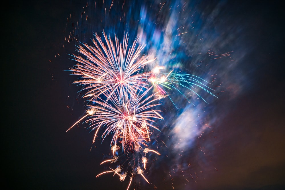 white and blue fireworks display during nighttime