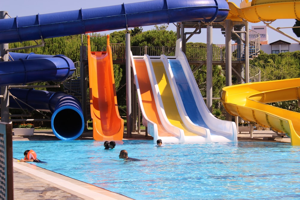 yellow and blue slide on swimming pool
