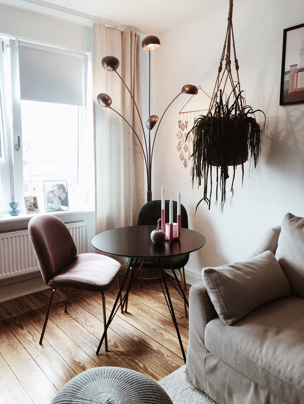 black metal framed brown wooden round table near white sofa