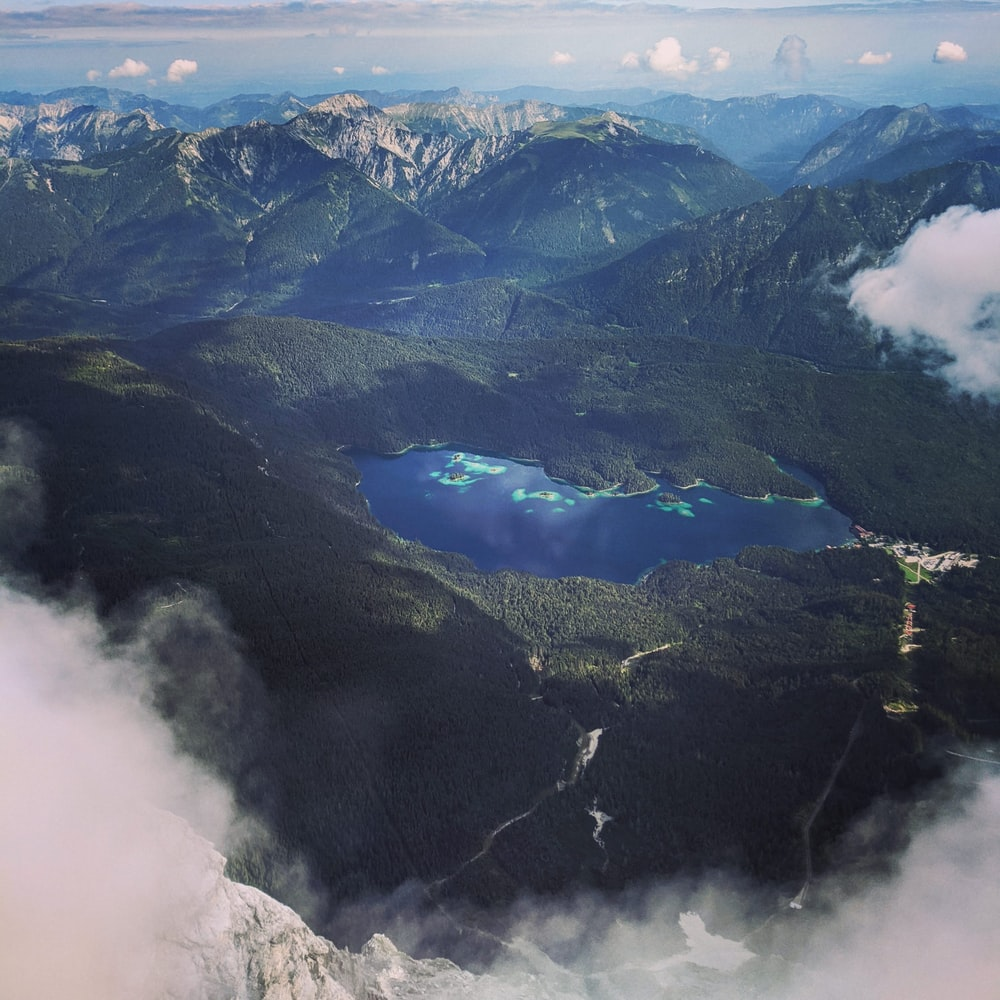 aerial view of green mountains and trees during daytime