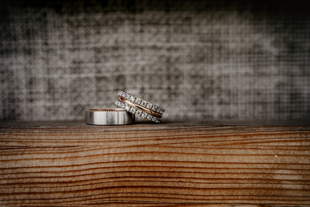 silver and black battery on brown wooden table