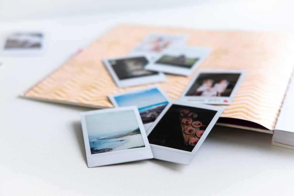 photos on white wooden table