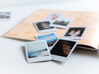 photos on white wooden table