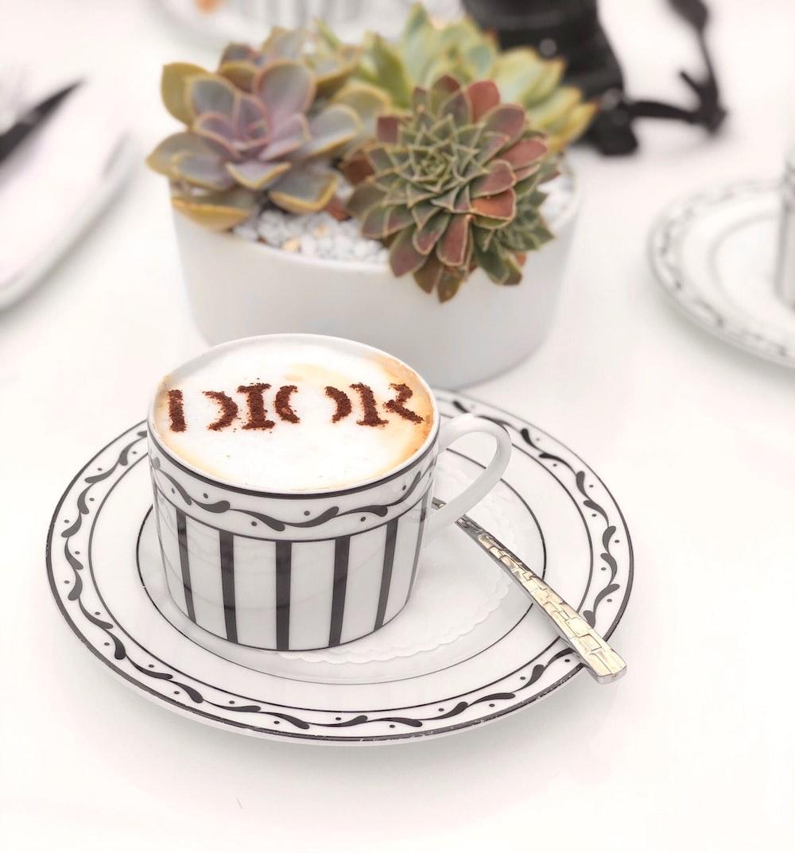 white ceramic mug on white ceramic saucer