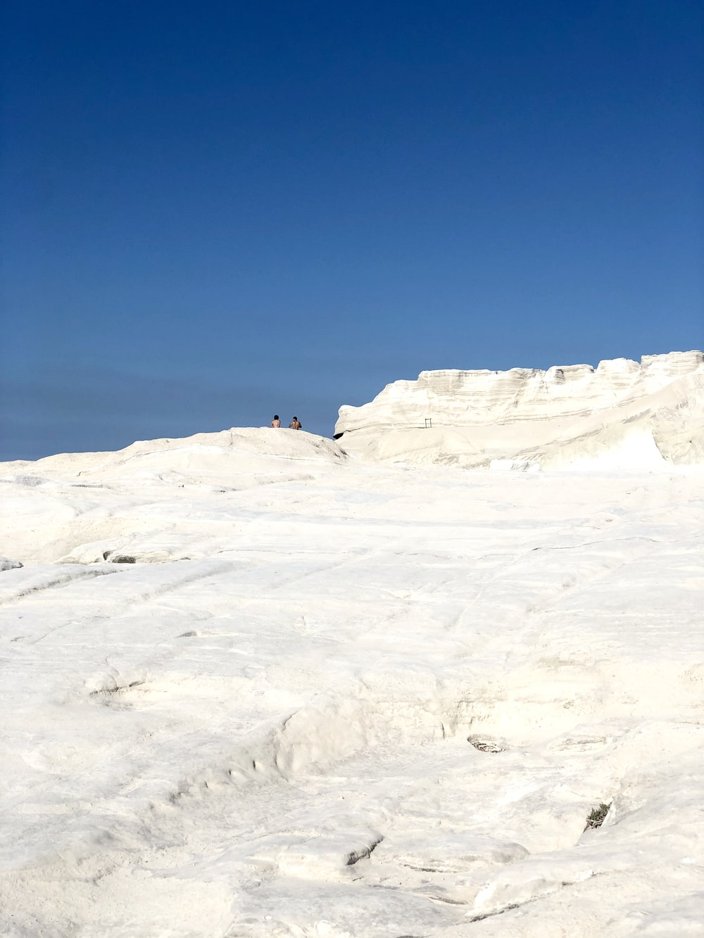white and gray rock formation under blue sky during daytime