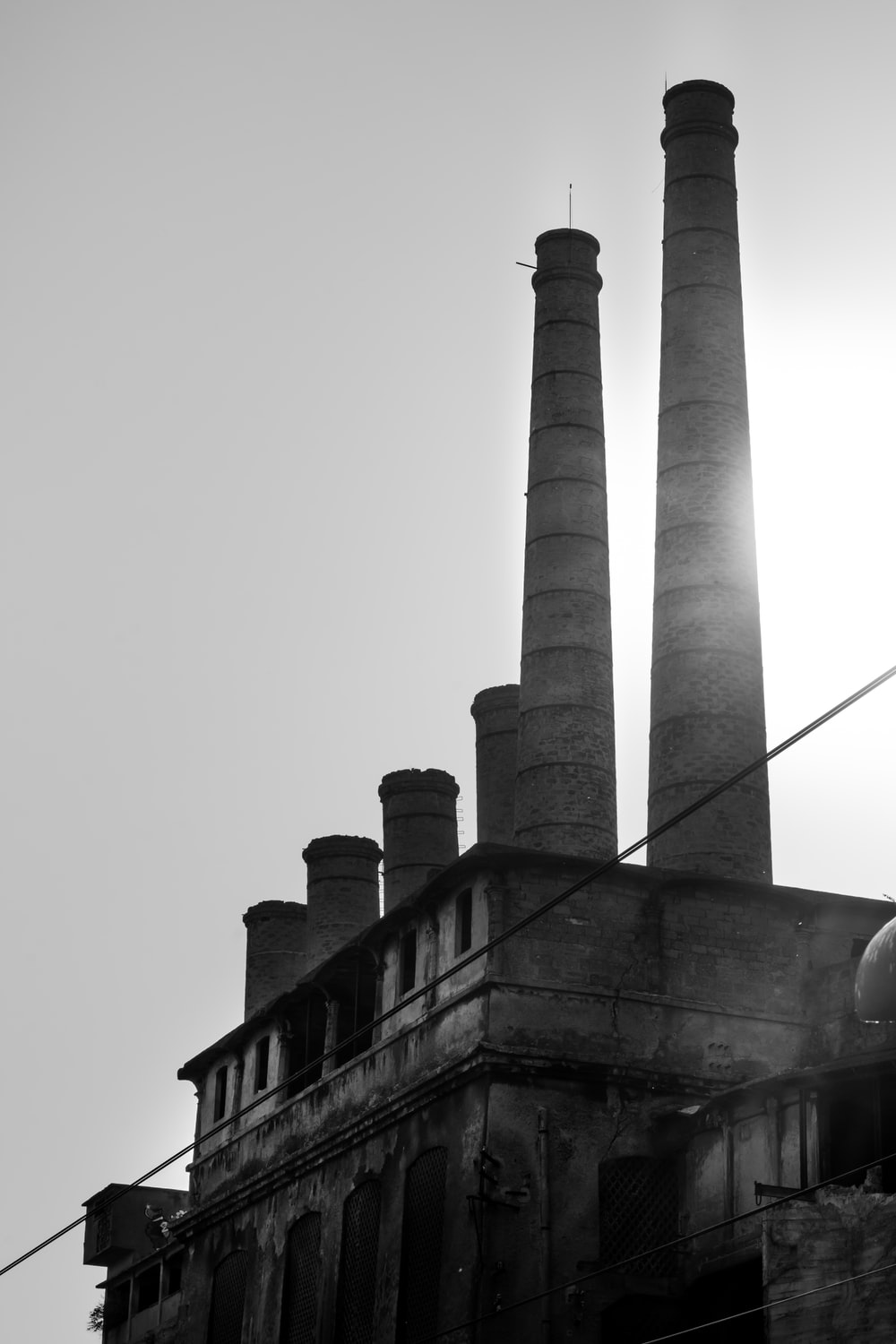 grayscale photo of concrete tower