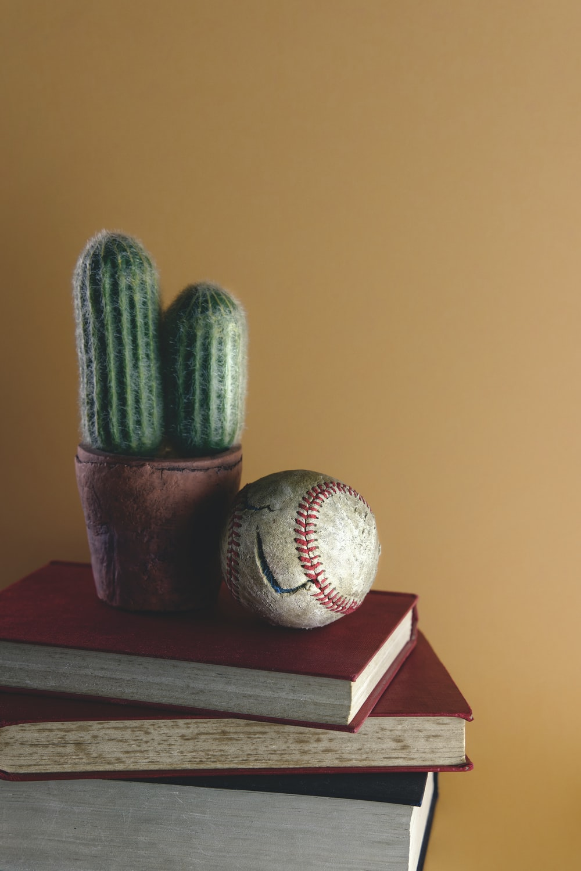 white baseball on brown wooden table