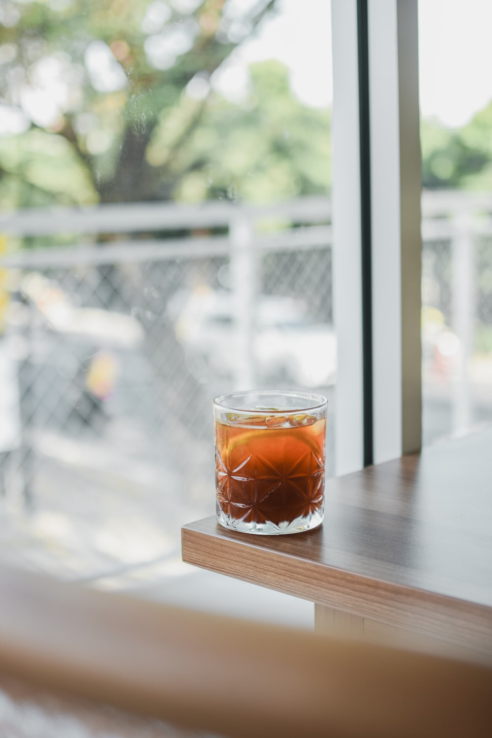 clear drinking glass with brown liquid inside