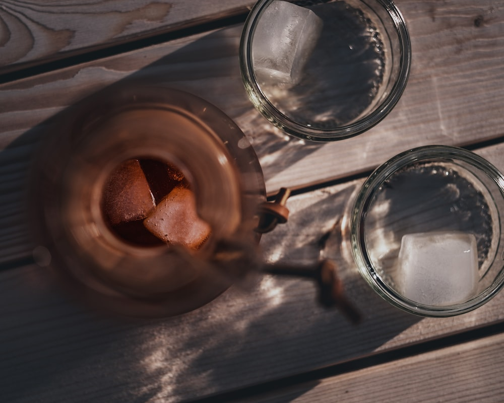 clear glass mug on brown wooden round tray