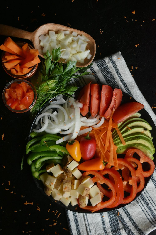 sliced tomato and green vegetable salad