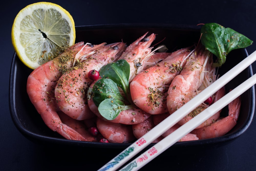 raw fish on black container