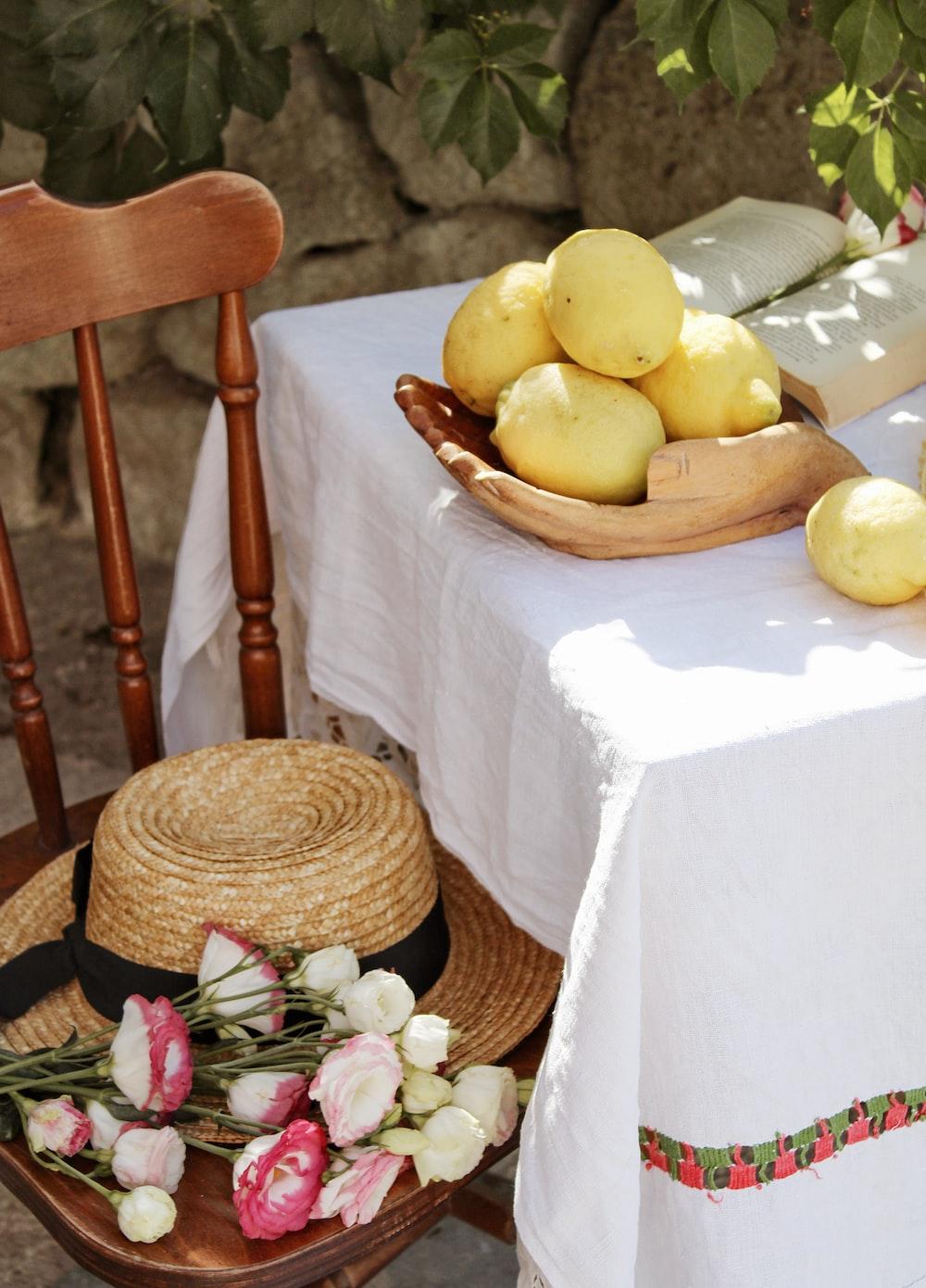 yellow lemon fruit on brown woven basket