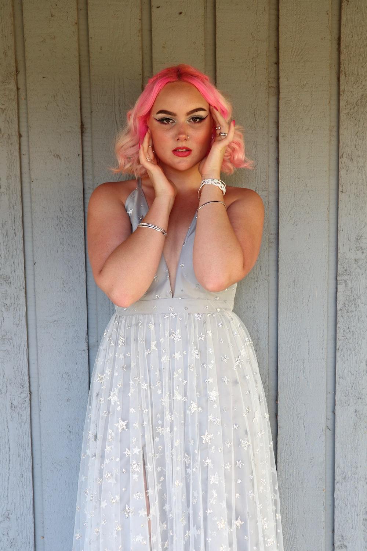 woman in white sleeveless dress