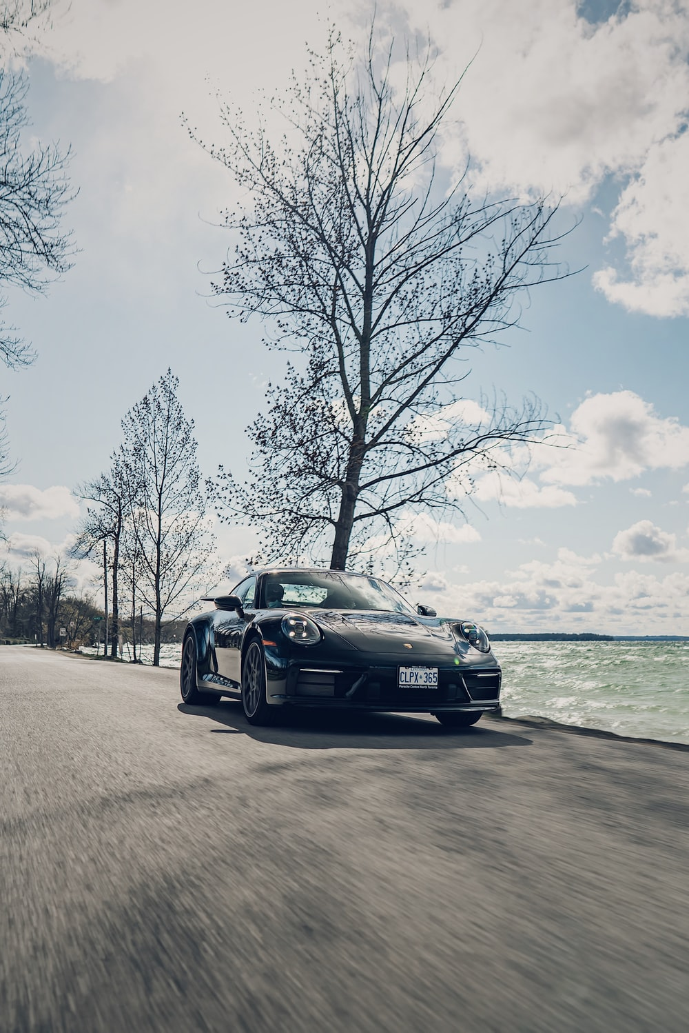 black porsche 911 on beach during daytime