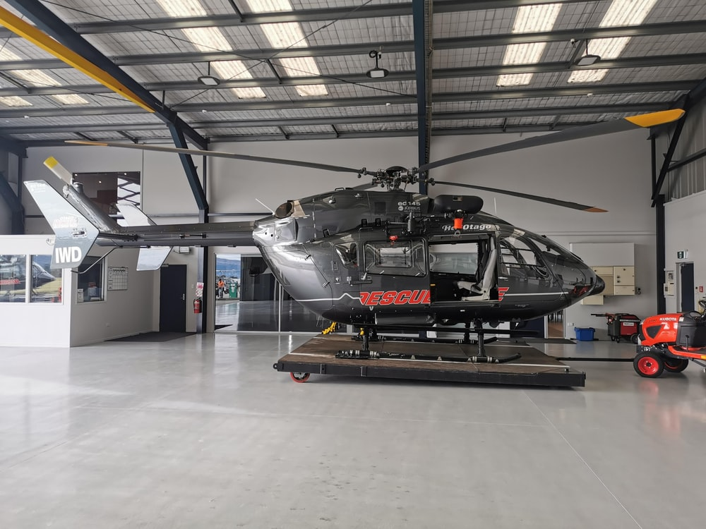 white and black helicopter in a room