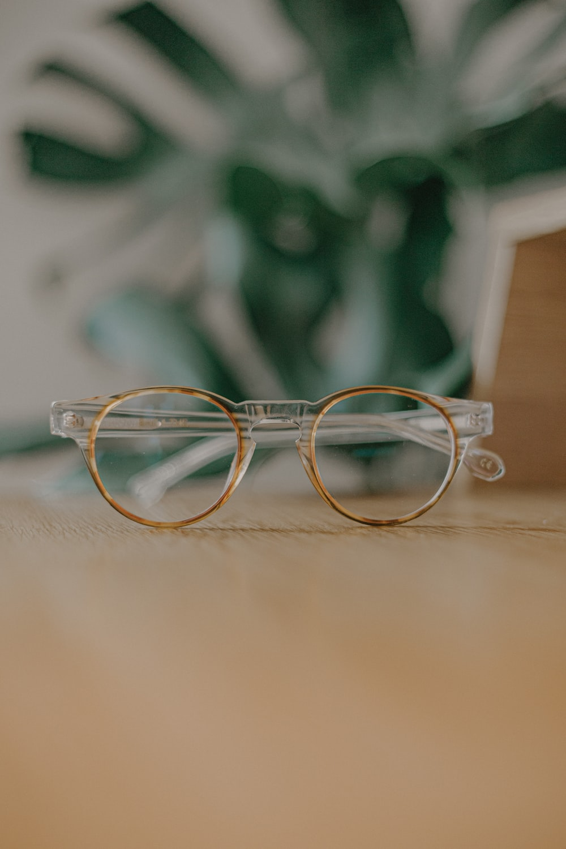 silver framed eyeglasses on white table