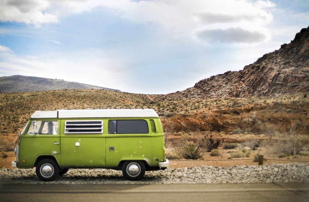 green van on road during daytime