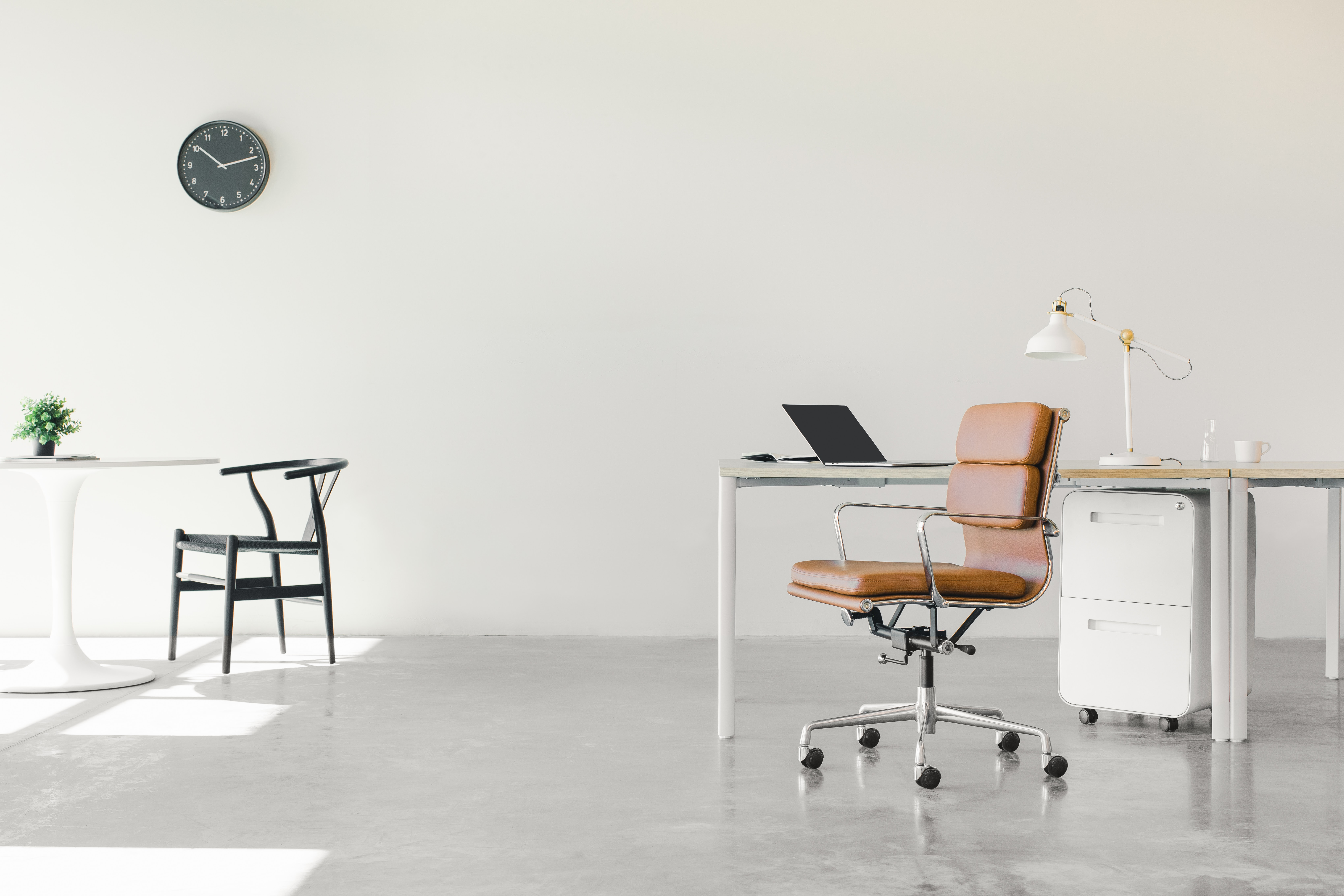 white office black and brown office rolling chair
