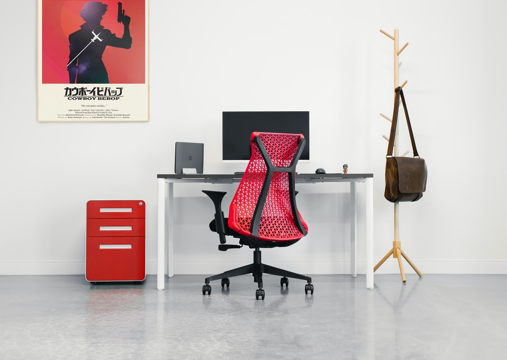 red and black office rolling chair