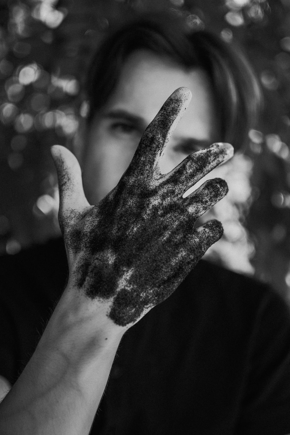 grayscale photo of persons left hand