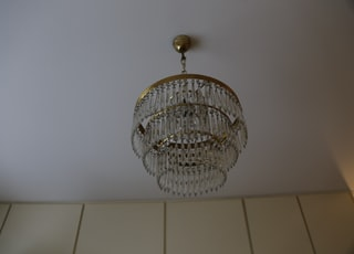 silver and gold round chandelier