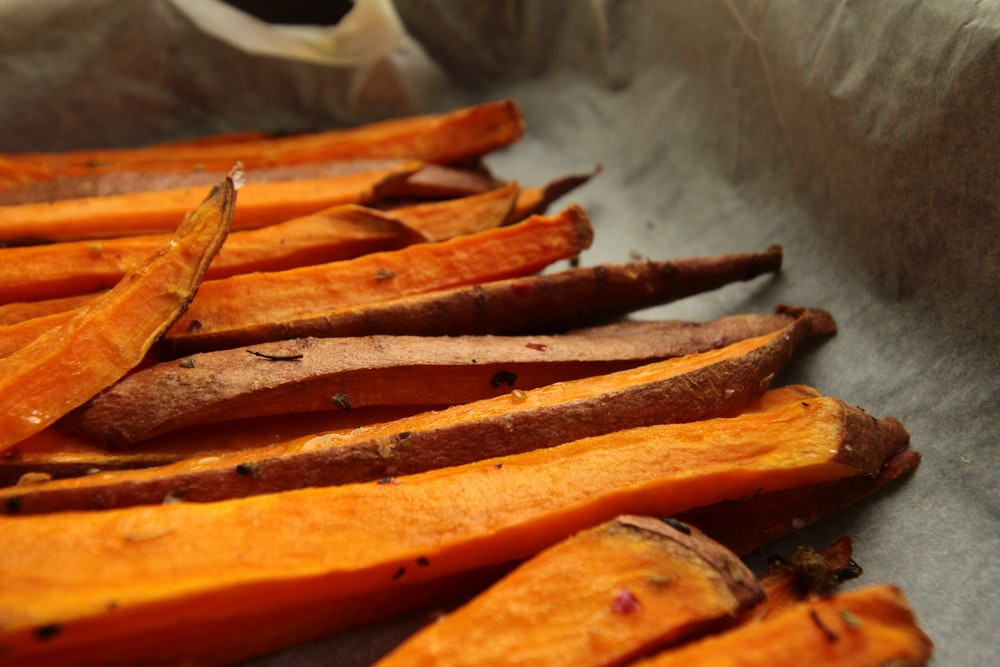 sliced carrots on stainless steel tray