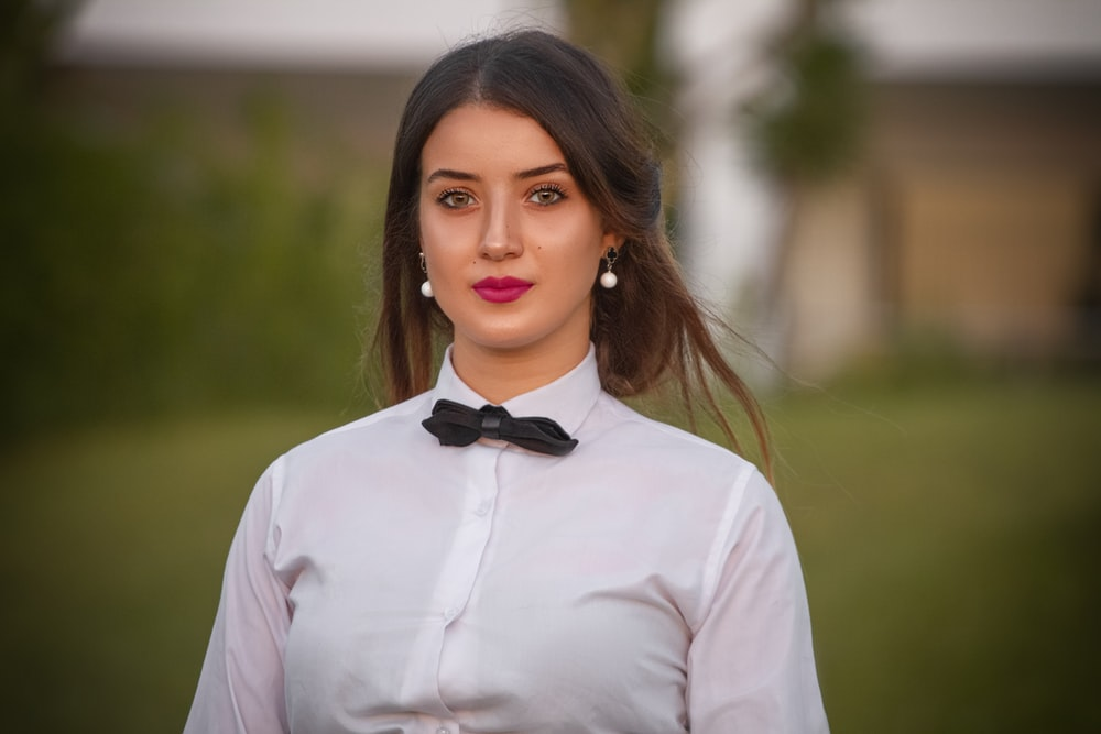 woman in white dress shirt and black bowtie