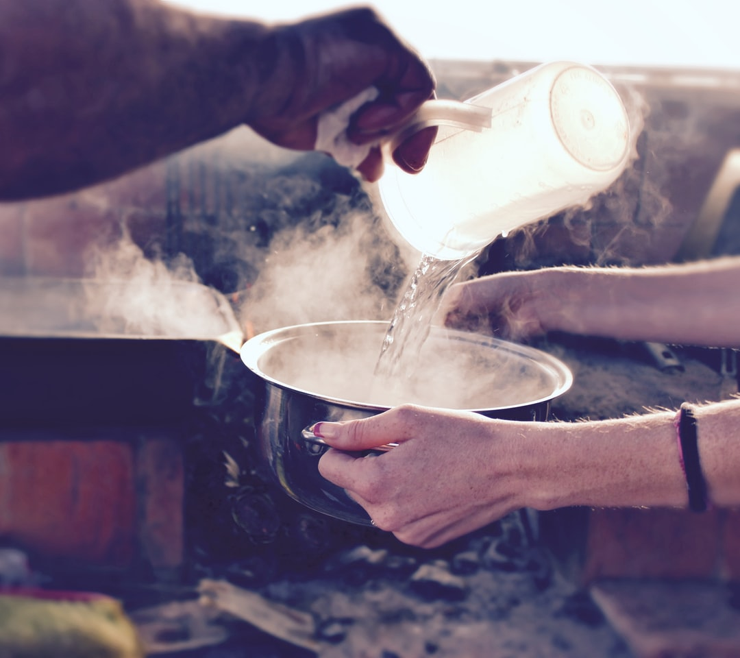 """Pouring hot water into a bowl. ❤️  This photo is free for public use. Please credit this photo in the caption with a link to """"www.joesonlinejobs.com"""". Thank you! Cheers, Joe."""