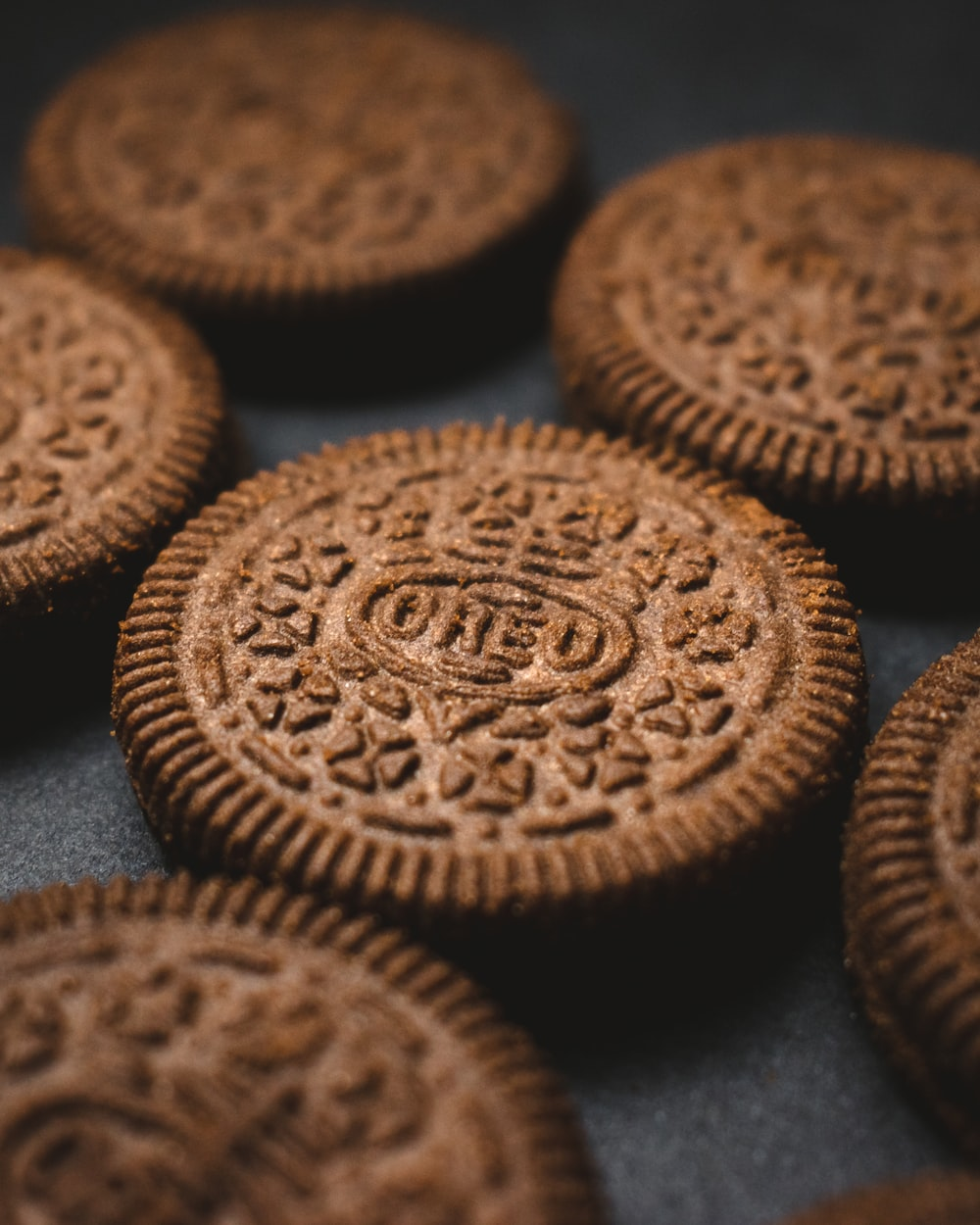 brown cookies on black textile