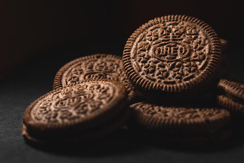 brown cookies on black surface