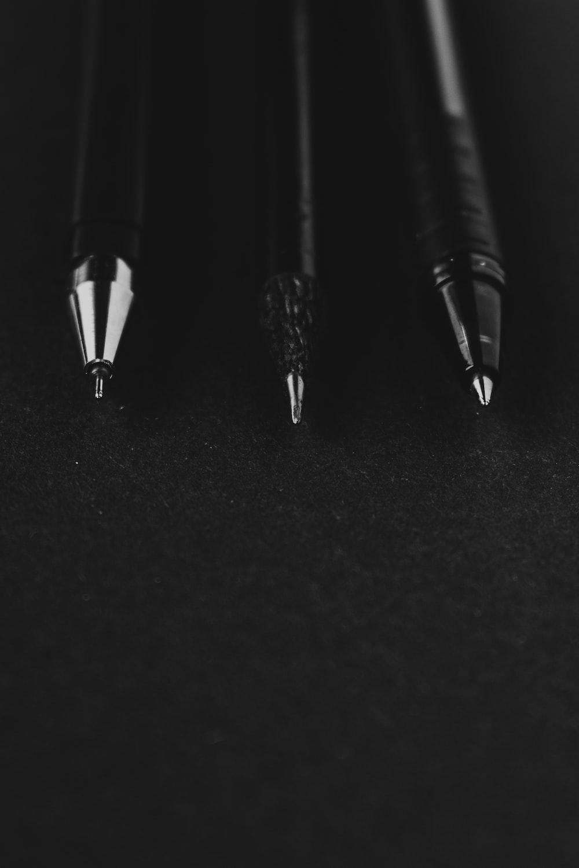 silver and black click pen