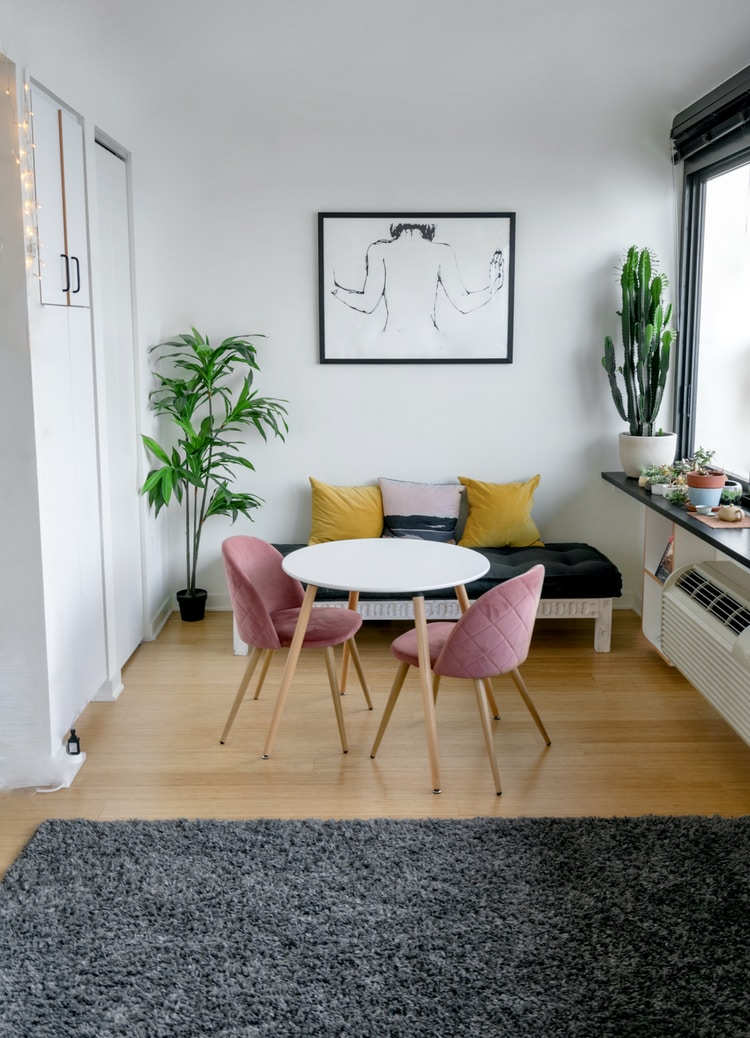 white and pink round table beside white wall