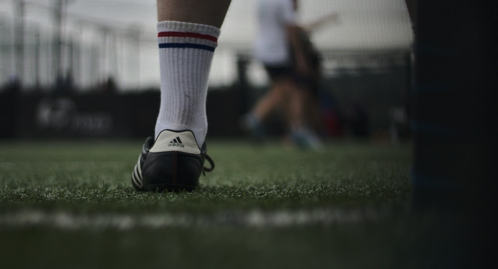 person wearing white and gray sock