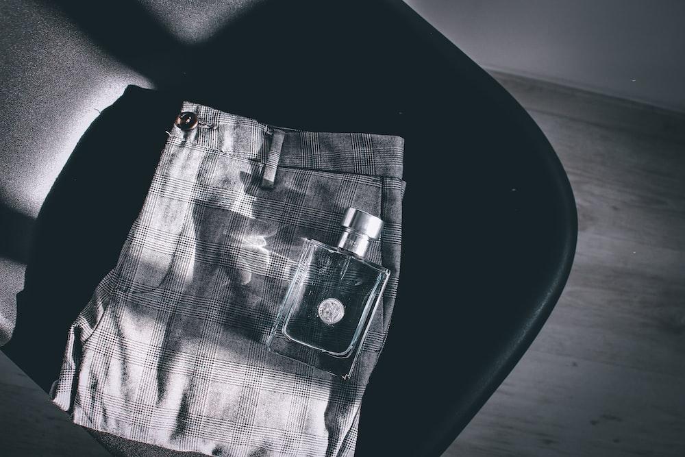 silver blister pack on black textile