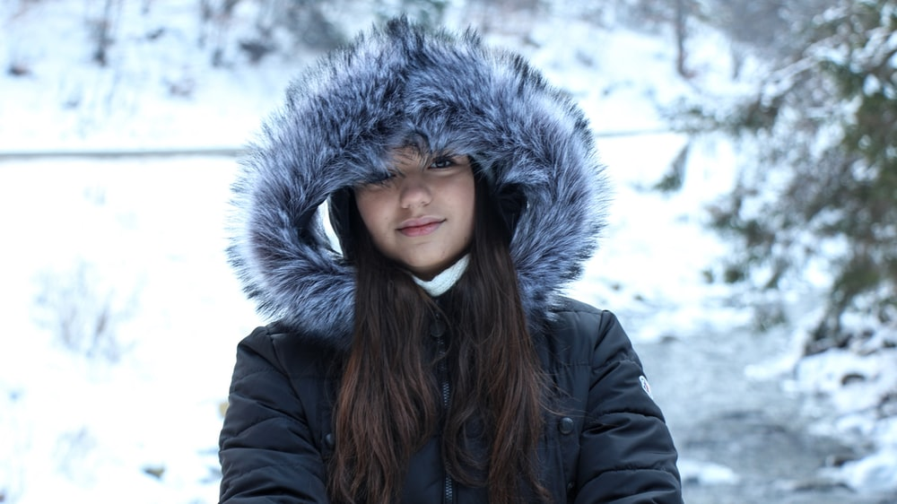 woman in black jacket and gray fur scarf
